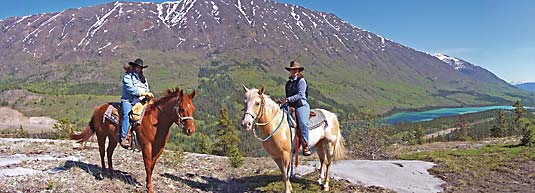 Horseback panoramic picture with Caribou Mountain and Spirit Lake in the backdrop